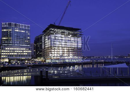 South Boston Massachusetts USA - December 8 2016: Rising steel frame of 50 Liberty project in South Boston overlooks Boston harbor just before dawn
