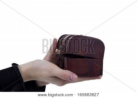 Antique casket in female hands on a white background