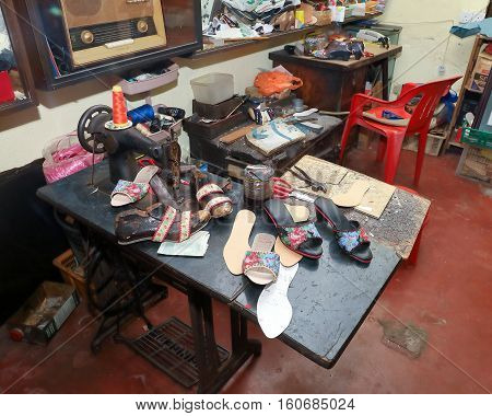 Bounded feet beaded Shoe Cobbler makers craft workspace