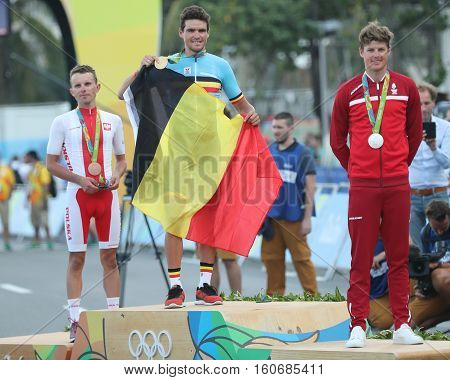 RIO DE JANEIRO, BRAZIL - AUGUST 6, 2016: Rafal Majka POL (L), Olympic champion Greg Van Avermaet BEL and Jakob Fuglsang DEN during men Cycling Road medal ceremony of the Rio 2016 Olympic Games