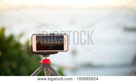 Closeup phone shooting time laps sunrise view
