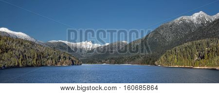 Capilano Reservoir Lake    Snow-Capped Mountains Lions Peaks Vancouver  British Columbia Pacific Northwest