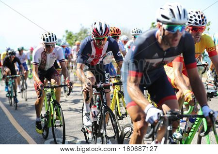 RIO DE JANEIRO, BRAZIL - AUGUST 6, 2016: Cyclist Brent Bookwalter of Team USA (center) rides during Rio 2016 Olympic Cycling Road competition of the Rio 2016 Olympic Games in Rio de Janeiro