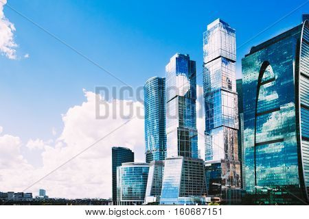 Beautiful urban landscape with views of the Moscow City complex of skyscrapers on a background of blue summer sky with clouds