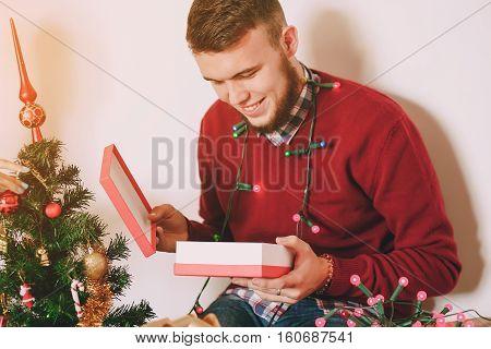 loving couple decorating Christmas tree. uses communication. give gifts