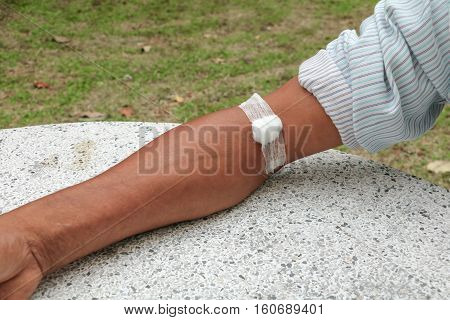 Bandage and gauze on an arm after a blood test :Select focus with shallow depth of field.