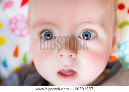 Close Up Of A Baby Face With Big Blue Eyes