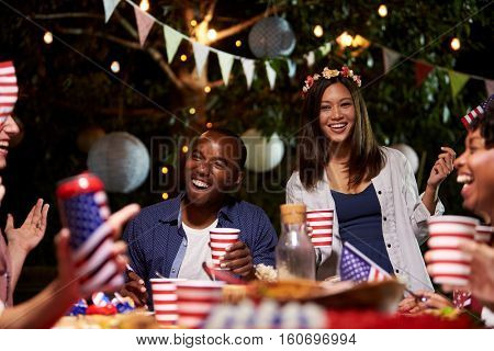 Friends Celebrating 4th Of July Holiday With Backyard Party