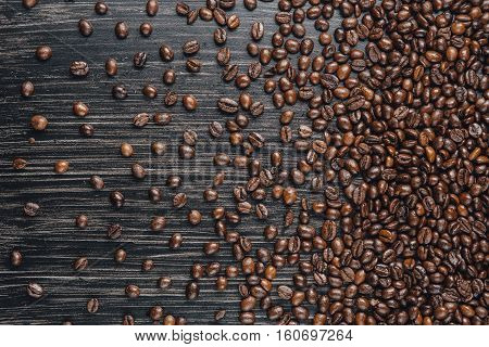 Close-up image of coffee beans on dark background