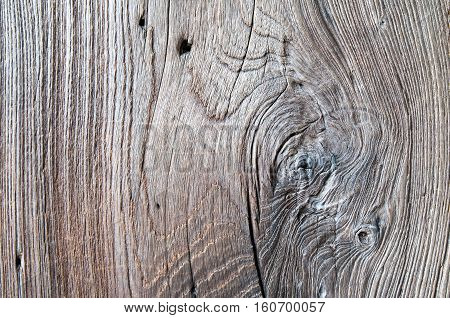 Surface from an old crannied and blackened by time wooden planks. Texture.