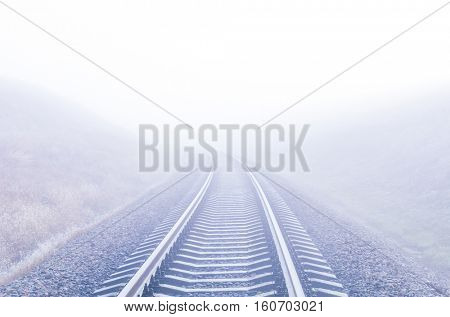 railway to foggy horizon
