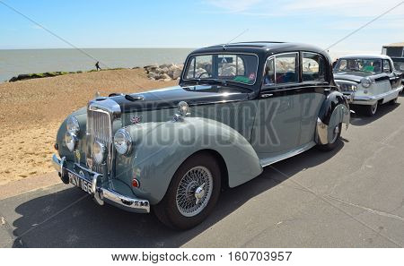 FELIXSTOWE, SUFFOLK, ENGLAND - MAY 01, 2016: Classic Alvis Grey Lady motor car parked on seafront promenade.