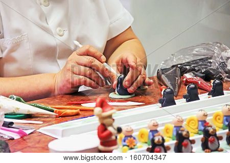 marzipan figurines the process of making sweet decorations for cakes and pies female hands a museum-factory marzipan