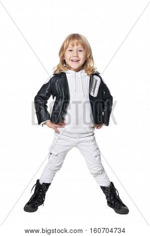Full length portrait of cute little boy in black leather jacket isolated on white background
