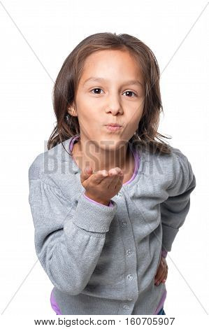Portrait of cute little girl sending air kiss isolated on white background
