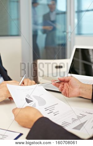 Sheet of paper with graphs in hands of a businesswoman