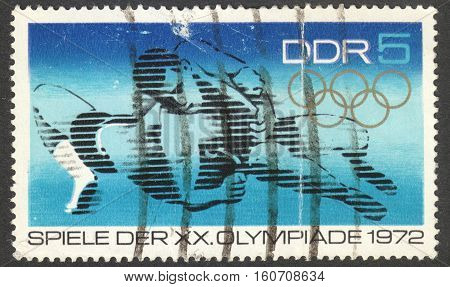 MOSCOW RUSSIA - CIRCA NOVEMBER 2016: a post stamp printed in the DDR shows a fighter the series