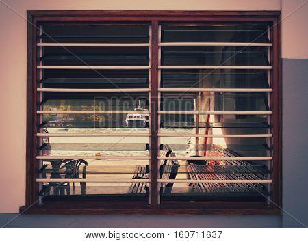 Photo of the ship through the window sash