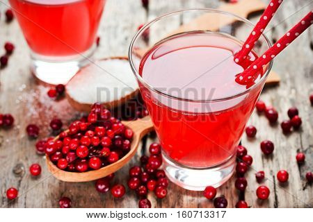 Fresh cranberry drink on wooden background. Red bilberry whortleberry huckleberry cowberry foxberry lingberry lingonberry mountain cranberry lingenberry berry cocktail wine liqueur