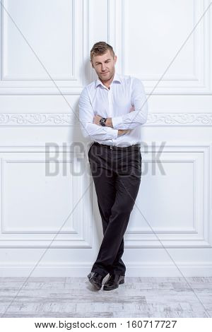 Business concept. Men's beauty, fashion. Full length portrait of a handsome mature man wearing classic white shirt.