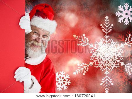 Santa claus peeking from red wall against digitally generated christmas background