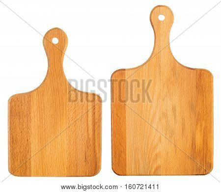 Set of new wooden chopping boards isolated on white. Top view