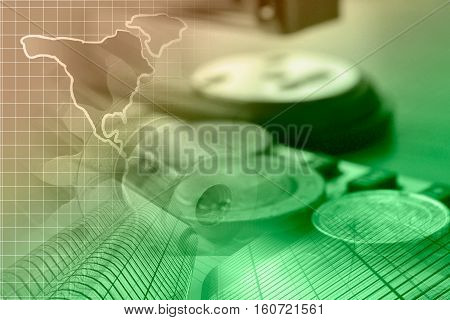 Business background with map stapler and coins toned.