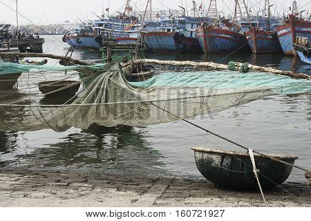 Traditional Fishing Boat with Net and Woven Bamboo Basket Boat At The Fishing Village in Da Nang. December 26, 2013 - Da Nang, South Vietnam