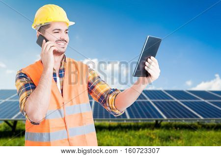 Successful Workman On Cellphone And Tablet In Hand