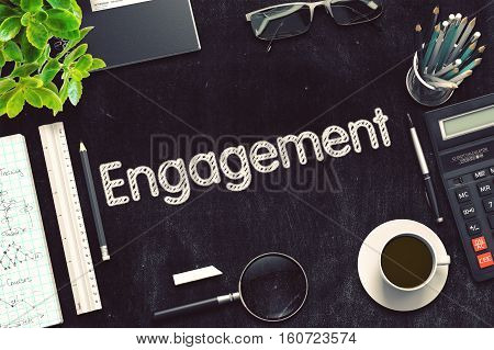 Engagement on Black Chalkboard. 3d Rendering. Toned Illustration.