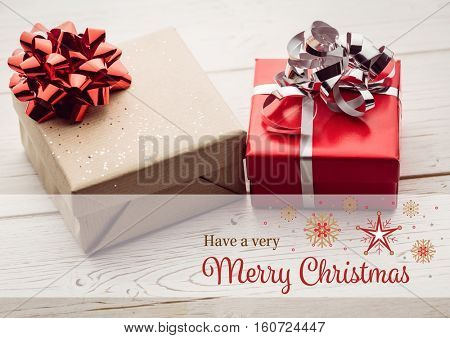 Digitally composite image of merry christmas against christmas gifts on wooden plank