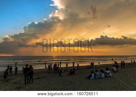 Beautiful sunset of Kuta Beach Bali Indonesia. Silhouettes of people at sunset on Kuta beach in Bali Indonesia