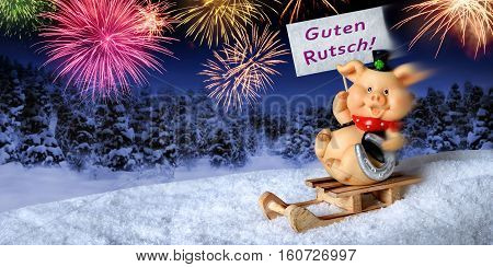 Lucky pig on a sleigh holding a sign saying