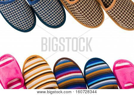 Rows of men's and women's slippers isolated on white
