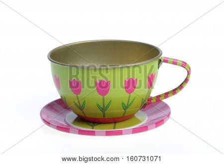 Nice metallic tea cup with plate, toys for kids, isolated on white background