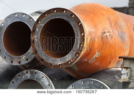 Stack of industrial reusable rusty metal pipes