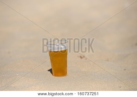 Photo Of Cold Beer In The Hot Sand. Drops Of Water On Glass. Thirsty Concept. Summer Time. Holiday.