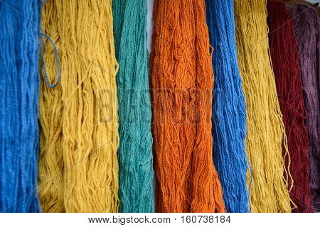 Multicolored wool fibers pattern as illustation about wool production and sell.