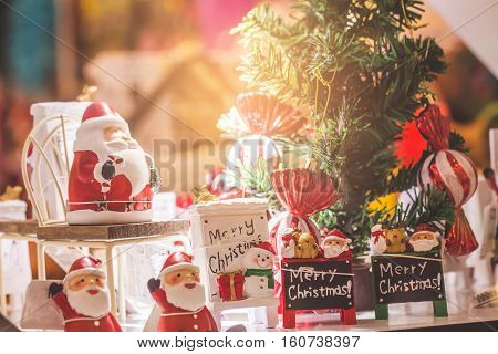 Cute Stuffed Toy Santa Claus Giving A Christmas Present. Stuffed Toy Santa Claus, A Bag Of Presents