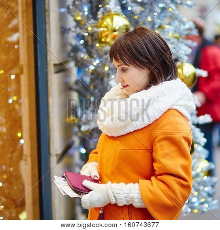 Worried Young Woman Holding Purse With Russian Roubles