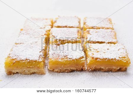 Lemon squares on baking paper sweet food