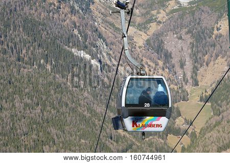 Dolomites , Italy - December 23, 2015: Nebelhorn cable car moving up Nebelhorn Mountain in winter time. The cable car offers close views of the Nebelhorn summit.