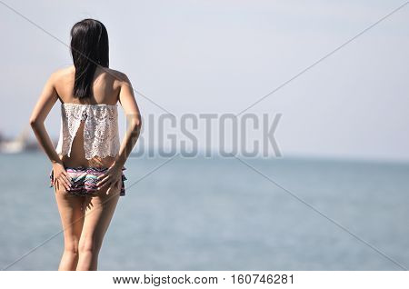 Korean girl on the beach, korean style bikini
