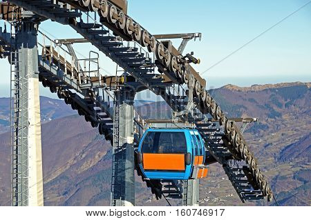 Chairlift mechanical pulleys in ski resort . Gear cable car
