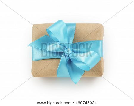 brown paper gift box with blue ribbon bow top view, white background