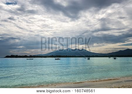 Tropical sea with dramatic sky. Sun rays shining through the clouds