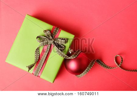 Green Gift Box Tied With Red And Green Ribbon