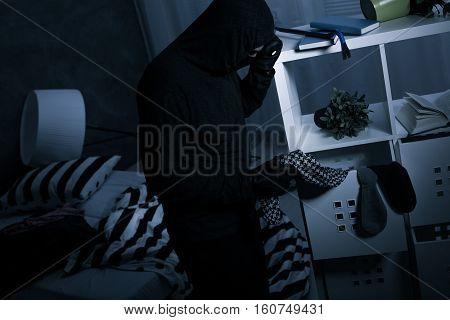 Robber In Dark Messy Room