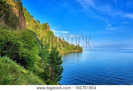 Blue water deep clear lake summer day. Baikal. Eastern Siberia. Russia