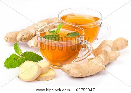 cup of hot tea with ginger, lemon and mint on a white background